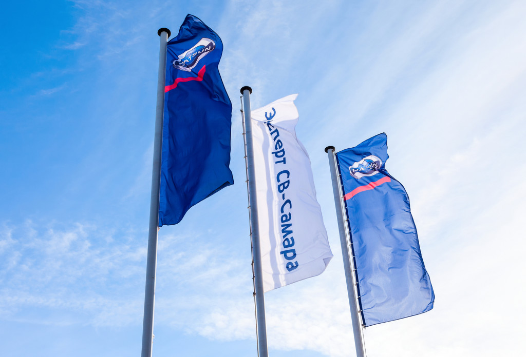 SAMARA RUSSIA - MARCH 1 2015: The flags of official dealer Datsun over blue sky. Datsun is an automobile brand owned by the Nissan Motor Company